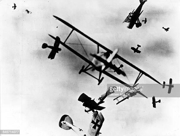 British and German fighter planes engaged in an air combat over France- no further information- undated
