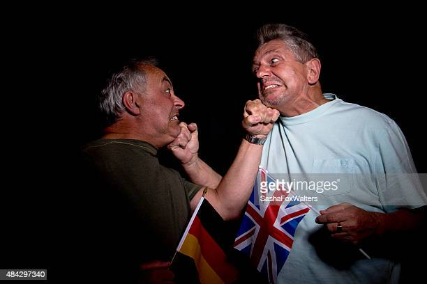 british and german patriots fighting - unfairness stock pictures, royalty-free photos & images