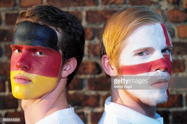british and german sports fans - soccer body painting stock photos and pictures