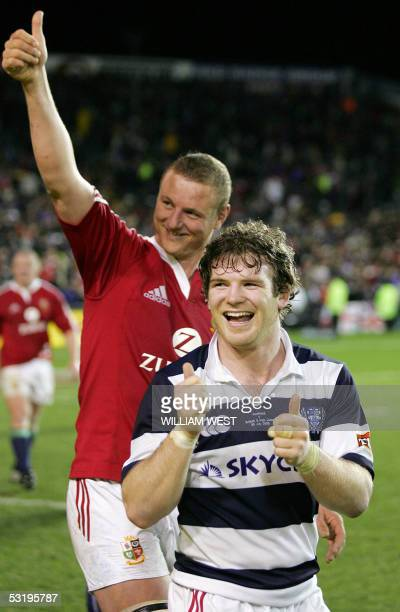 British and Irish Lions centre Gordon D'Arcy and lock Brent Cockbain wave to the fans after their match against Auckland played at Eden Park in...