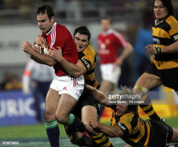 British and Irish Lions' Charlie Hodgson tries to escape the Taranaki defence during their 3614 victory