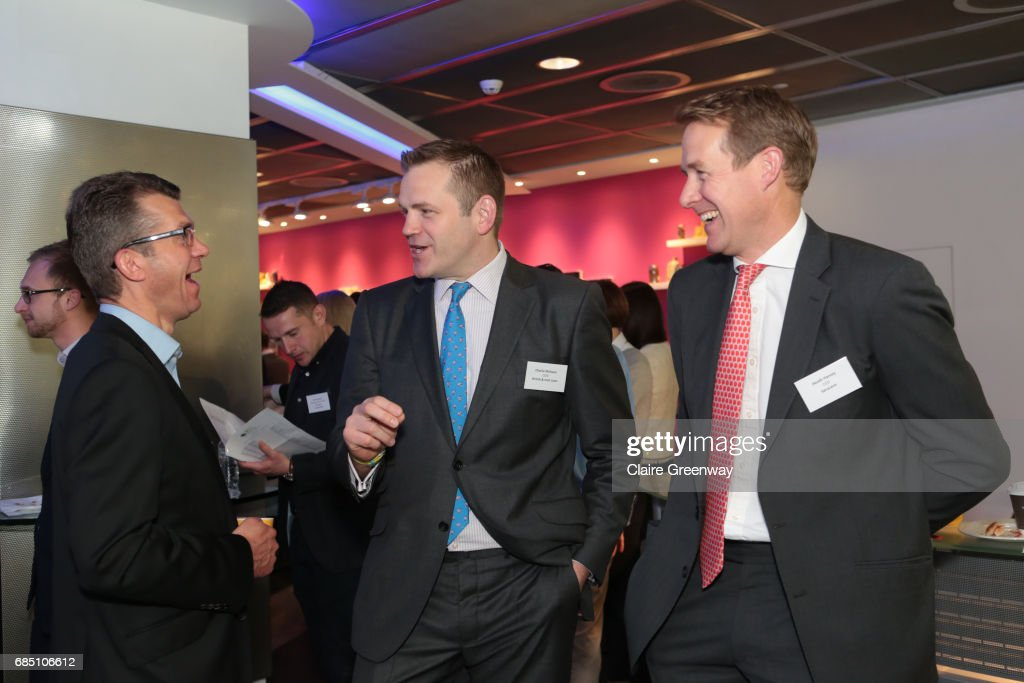 British and Irish Lions, Charlie McEwan (C) and CEO Saracens, Heath Harvey (R) speak with a guest at The Sport Industry Breakfast Club, supported by Deltatre and hosted by BT Sport, at the BT Centre on May 19, 2017 in London, England.