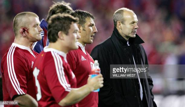 British and Irish Lions coach Sir Clive Woodward and his team members Simon Shaw Gordon Bulloch and Graham Rowntree reflect as they look over at the...