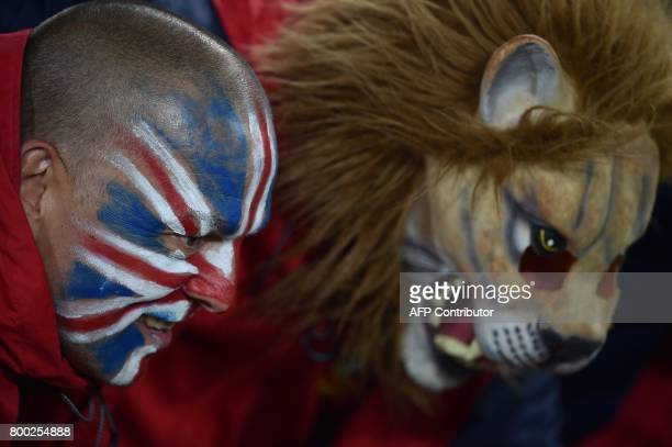 TOPSHOT British and Irish Lions fans are photographed as they wait for the start of the rugby Test match against the New Zealand All Blacks in...