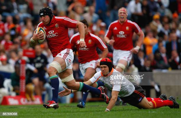 British and Irish Lions forward Stephen Ferris races through to score the opening try during the match between the Cheetahs and the British and Irish...