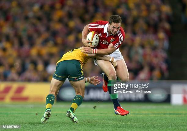 British and Irish Lions' George North is tackled by Australia's Adam AshleyCooper