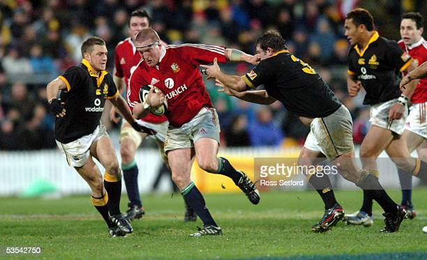 British and Irish Lions Gethin Jenkins fends off Wellington's Tim Fairbrother in the rugby tour match at Westpac Stadium Wellington New Zealand...