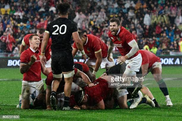 British and Irish Lions' Liam Williams and teammate Elliot Daly look at New Zealand All Blacks' Ardie Savea after the Lions won the second rugby...