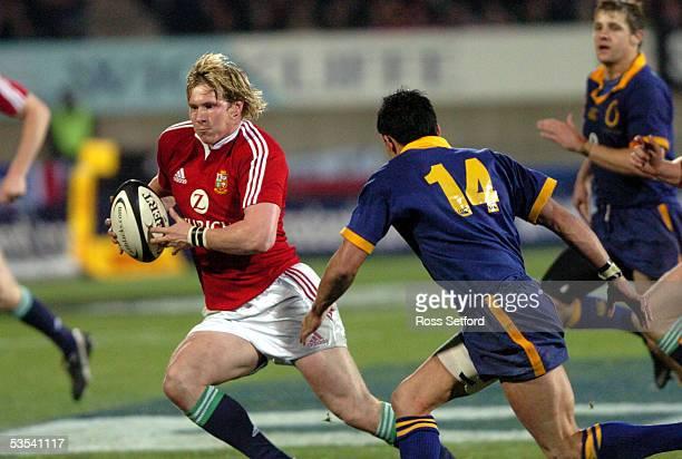 British and Irish Lions Ollie Smith, left runs around Otago's Hayden Pedersen in the rugby tour match at Carisbrook, Dunedin, New Zealand, Saturday...