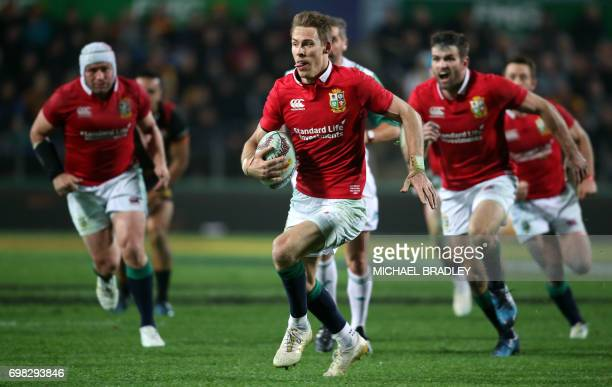 British and Irish Lions player Liam Williams makes a break during the rugby union match between the British and Irish Lions and the Waikato Chiefs at...