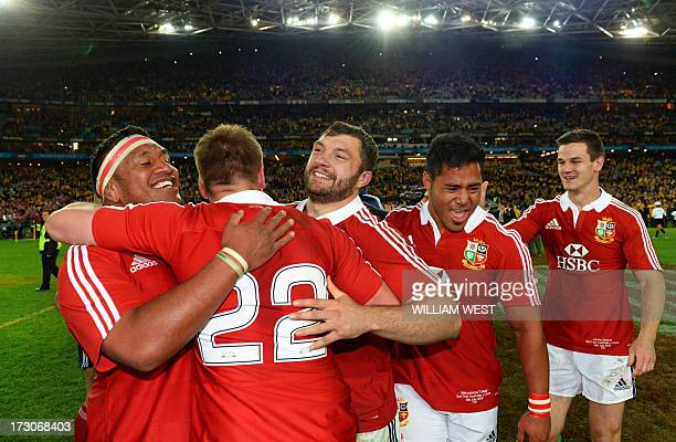 British and Irish Lions players Mako Vunipola Owen Farrell Alex Corbisiero Manu Tailagi and Jonathon Sexton celebrate after the Lions defeated the...