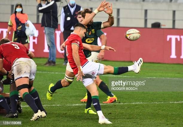British and Irish Lions' scrum-half Conor Murray kicks the ball during the first rugby union Test match between South Africa and the British and...