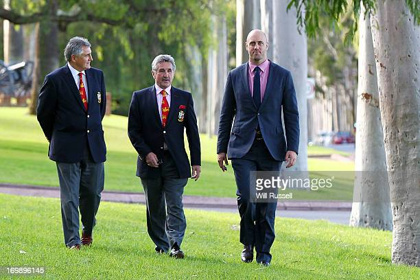 British and Irish Lions Tour manager Andy Irvine talks with British and Irish Lions Tour chairman Gerald Davies and former Wallaby captain Nathan...