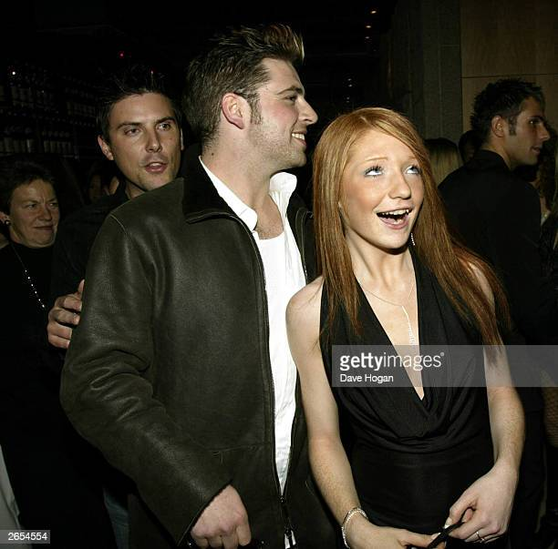 """British and Irish pop stars Mark Feehily and Nicola Roberts of the pop groups """"Girls Aloud"""" and """"Westlife"""" attend the """"Unbreakable"""" album launch at..."""