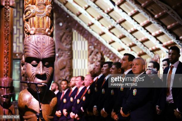 British and Lions rugby head coach Warren Gatland sings with the rest of the team in the meeting house during a Maori welcoming at Waitangi Treaty...
