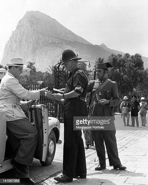 British and Spanish policemen checking the papers of a tourist passing past Gibraltar Gibraltar September 1939