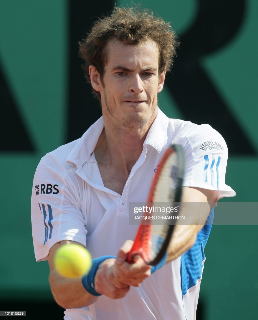British Andy Murray returns the ball to Cyprus' Marcos Baghdatis during their men's third round match in the French Open tennis championship at the Roland Garros stadium, on May 28, 2010, in Paris. The event, the second Grand Slam tournament of 2010, runs from May 23 to June 6, 2010.