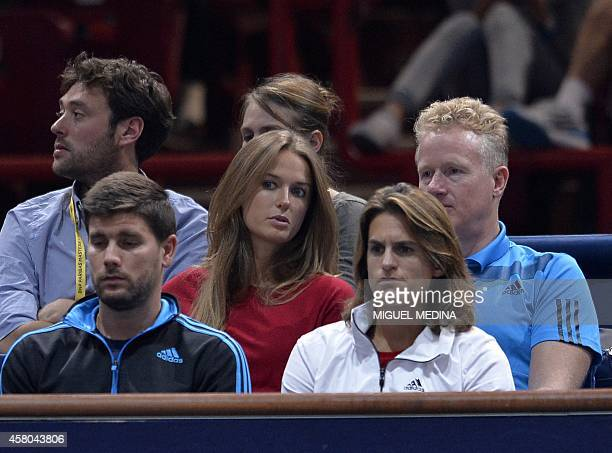 British Andy Murray's girlfriend Kim sears and his coach Amelie Mauresmo from France watch his game against France's Julien Benneteau during the...