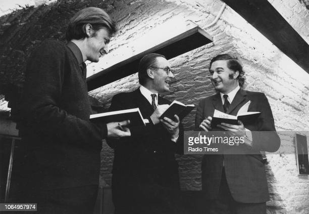 British Anglican priest Chad Varah in discussion with David Moore and Michael Butler in the Crypt of St Stephen Walbrook photographed for Radio Times...