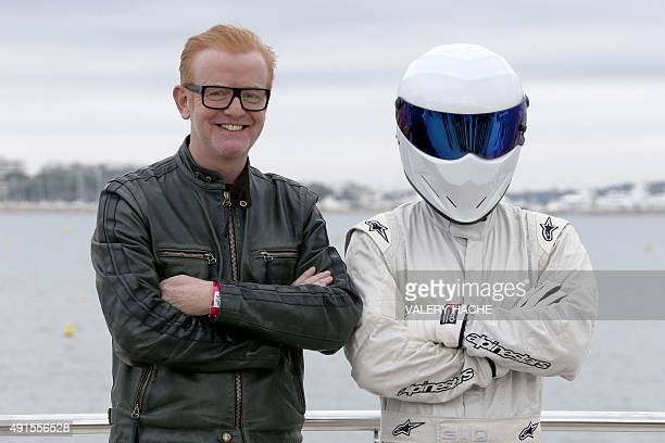 British animator Chris Evans poses next to an anonymous man during a photocall for TV show 'Top Gear' at the MIPCOM audiovisual trade fair in Cannes...