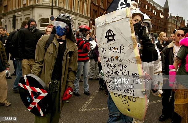 British anticapitalist protesters wear makeshift body armor at a May Day demonstration May 1 2002 in London There were sporadic clashes with police...