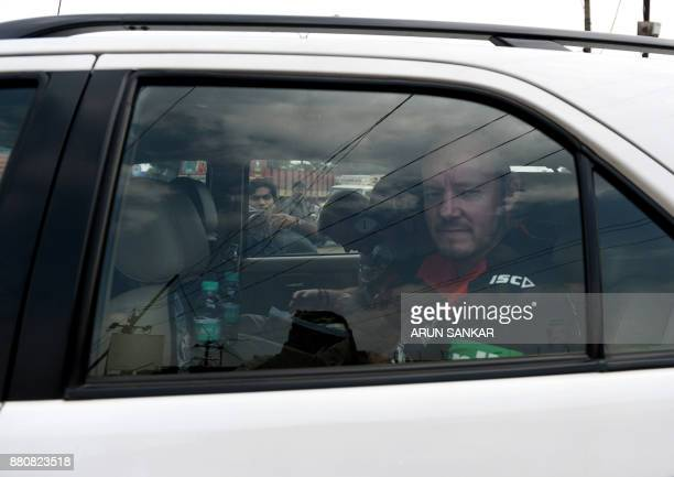 British antipiracy crew member Ray Tindall looks on from inside a car as he leaves prison in Chennai on November 28 2017 Six Britons who were among...