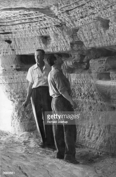 British archaeologist Lankester Harding in the caves on the northwest shores of the Dead Sea Jordan where Jewish holy scrolls identified as...