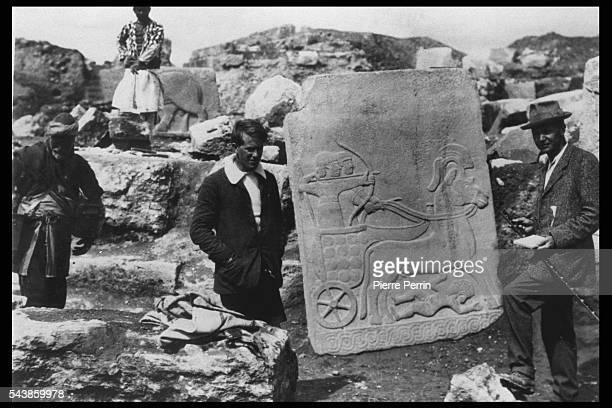 British archaeologist Leonard Woolley and T E Lawrence with a Hittite basrelief in basalt at the ancient city of Carchemish Turkey 1913