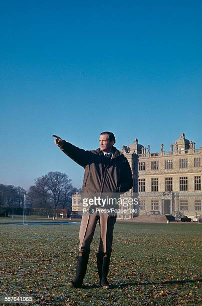 British aristocrat and politician Henry Thynne 6th Marquess of Bath pictured standing in the grounds of his stately home Longleat house in Wiltshire...