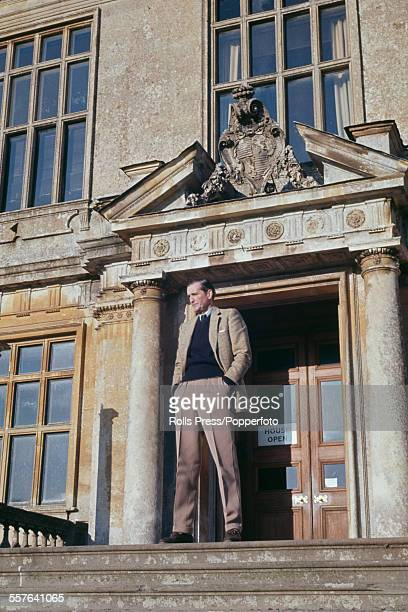 British aristocrat and politician Henry Thynne 6th Marquess of Bath pictured standing at the entrance of his stately home Longleat house in Wiltshire...