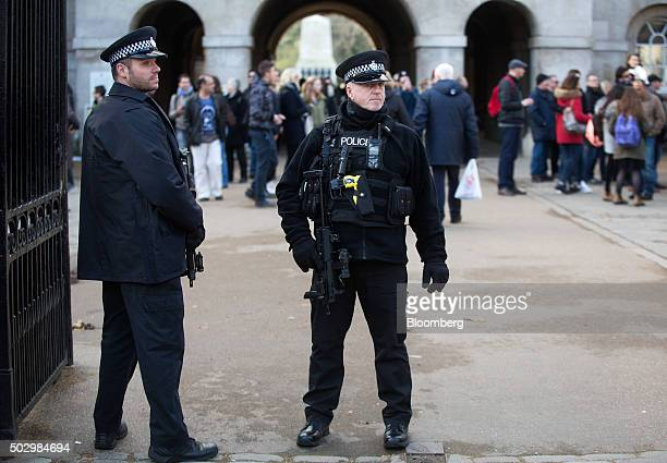 British armed police officers stand on guard at Horse Guards Parade in London UK on Thursday Dec 31 2015 Around 3000 police officers will be on duty...