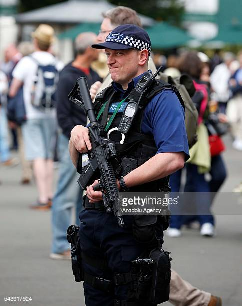 British armed police patrol around the complex on day four of the 2016 Wimbledon Championships at the All England Lawn and Croquet Club in London...