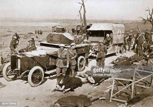 British armoured car near Guillemont France Somme campaign World War I 1916 Stretcher cases are lying beside the road and an ambulance stands behind...