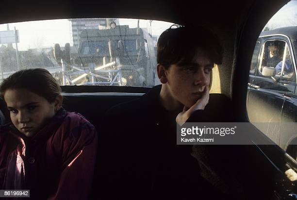 A British armoured vehicle seen through the back window of a black cab used to shuttle passengers in Catholic residential areas of west Belfast 28th...