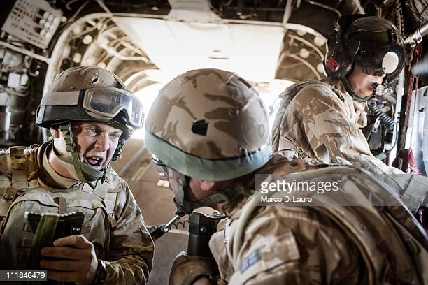 British Army A/CPL Roy Paddon 26yearsold from the RAF 34 SQN at Leeming member of the Immediate Response Team screams onboard of the MERT CH47...