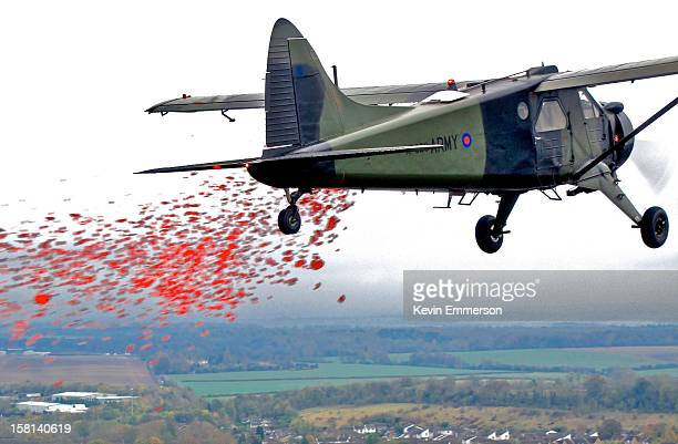 British Army Air Corps Historic Aircraft Flight DeHaviland Beaver aeroplane dropping poppies over Middle Wallop on Remembrance Sunday