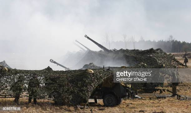 British army artillery guns shoot during the 'Dynamic Front 18' exercise in Grafenwoehr, near Eschenbach, southern Germany, on March 7, 2018....