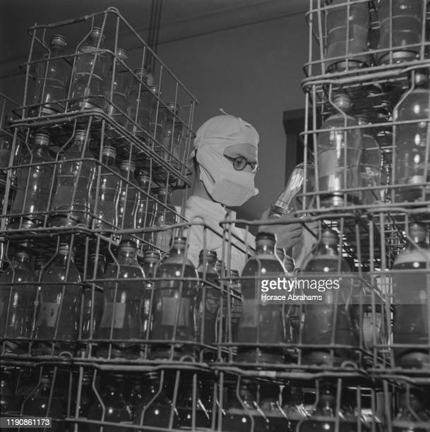 A British Army Blood Transfusion Service blood bank with crates of bottles of blood during World War II England May 1941
