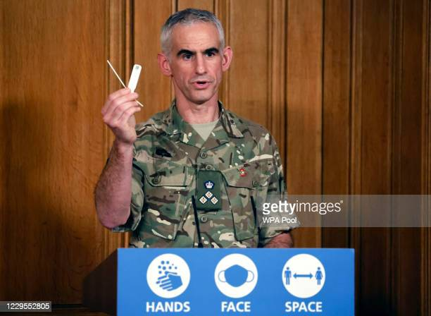 British Army Brigadier, Joe Fossey, who is coordinating the mass coronavirus testing pilot in Liverpool, holds up the components of a lateral flow...