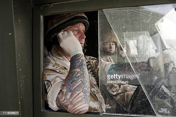 British Army CPL Steven Swain, 36-yeras-old from te 254 Med Regiment waits in his ambulance for the US Air Force Pedro Med Evac helicopter carrying...