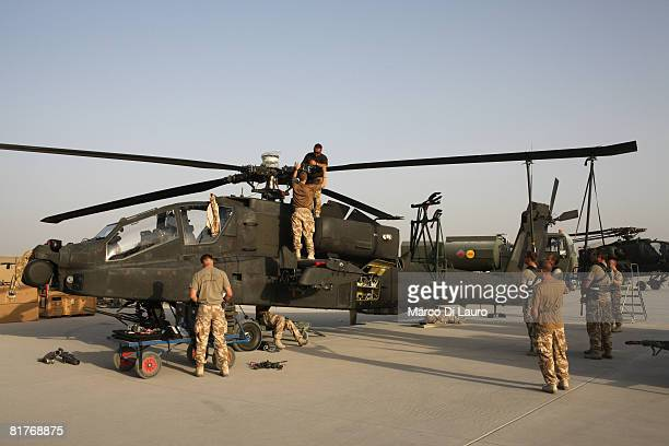 British Army engineers from 4th Regiment Army Air Corps 664 Squadron part of the Joint Helicopter Force work on an Apache helicopter on June 25 2008...