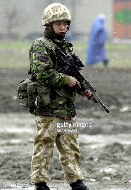 British army Gurkha soldier belonging to the NATOled International Security Assistance Force stands guard at the site of an apparent suicide attack...
