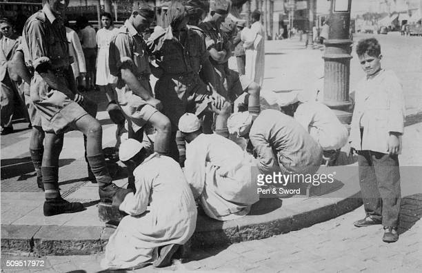 British army having their shoe shined while on leave in Cairo Egypt