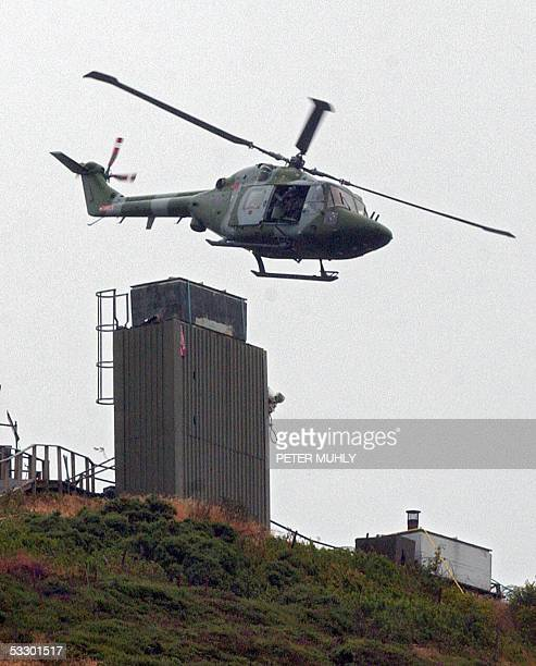 British Army helicopter leaves a watchtower at Sugar loaf mountain in Camlock Co Armagh 29 July 2005 The Army has begun dismantling a number of...
