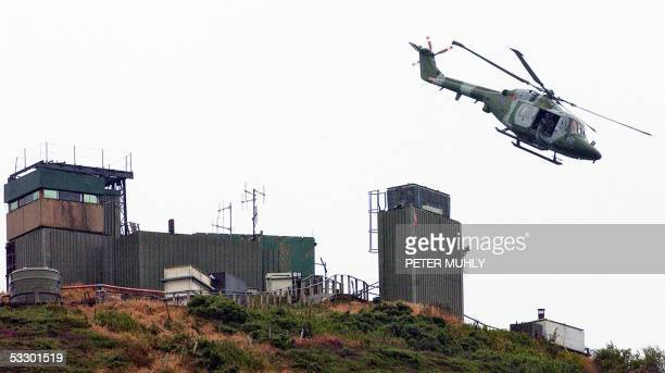 British Army helicopter leaves a watchtower at Sugar loaf mountain in Camlock, Co. Armagh, 29 July 2005. The Army has begun dismantling a number of...