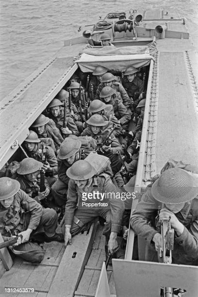 British Army infantry troops prepare to exit an armoured Royal Navy Landing Craft Assault as part of a large scale amphibious landing invasion...