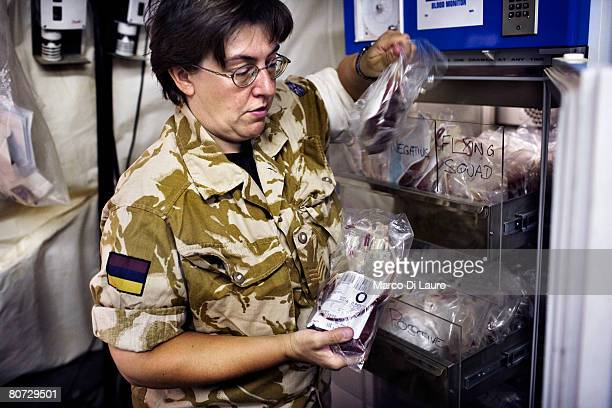 British Army Laboratories Technician Sgt Janet Nicholson checks blood before issuing to the operating theatre at the hospital Laboratory on June 8...