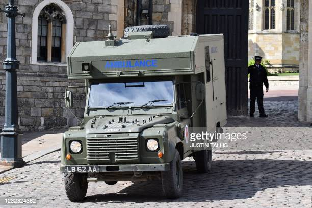 British Army Land Rover ambulance is driven away from Windsor Castle in Windsor, west of London, on April 15 after a rehearsal for the funeral of...