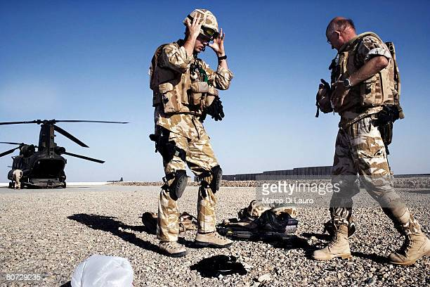 British Army Medical Emergency Response team Sgt Gavin Carr from the UK Med Group and British Army Anaesthetist Lt Col Ian Hicks prepare to get on...