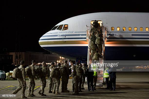 British Army medics board an aircraft as they depart for Sierra Leone at RAF Brize Norton on October 21 2014 in Brize Norton England The medics from...